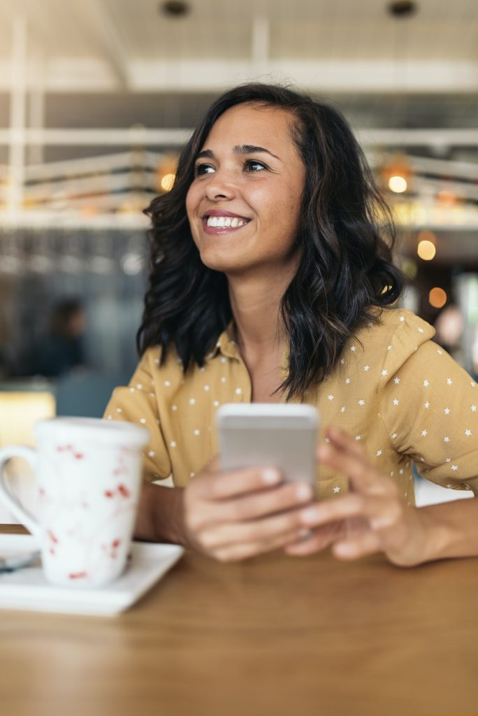 Portrait of beautiful woman using mobile.