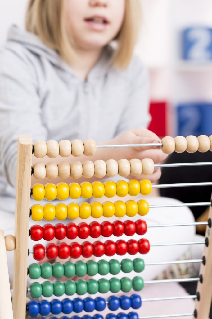girl learning to count using abacus PN37D42 AAC